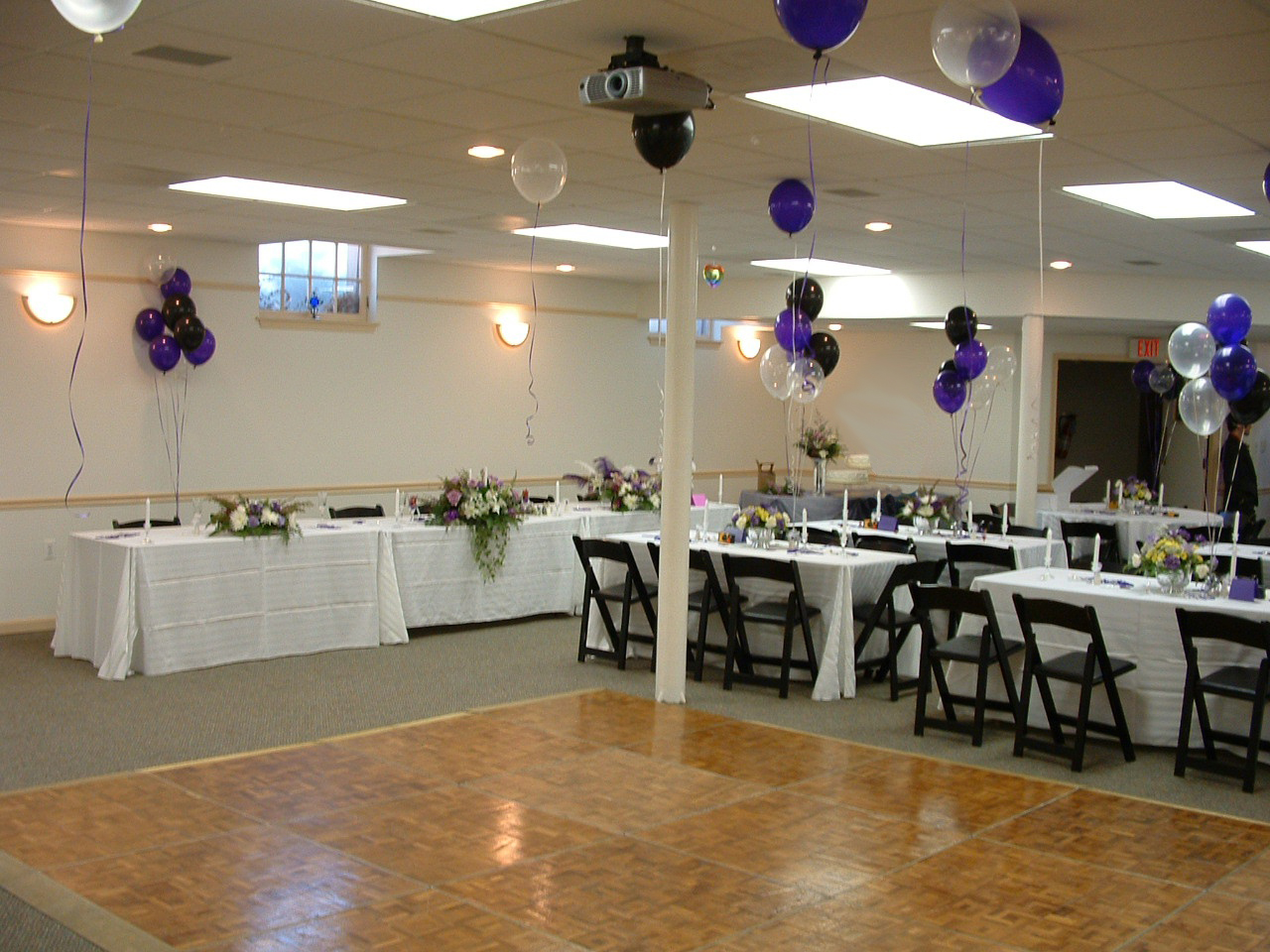 fellowship hall with wedding decorations and dance floor